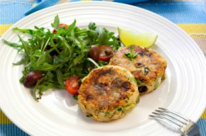 Salmon fishcakes with a side salad. Healthy, delicious seafood.